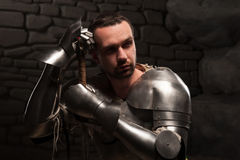 Medieval knight kneeling with sword Royalty Free Stock Photos