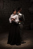 Medieval knight and lady posing Royalty Free Stock Image
