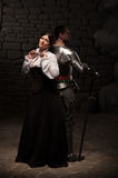 Medieval knight and lady posing Stock Images