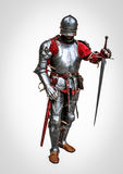 Armoured knight. With the sword isolated on the white background Royalty Free Stock Photos