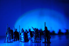 Medieval knight miniature figurines toy, Legionary warrior knight souvenir miniature figurines,arch light dark background Stock Images