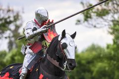 A medieval knight prepare to fight during jousting tournament. Knights compete during re-enactment of medieval jousting tournament royalty free stock photo