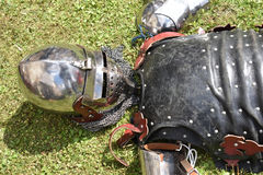 Medieval knight`s armor: helmet, cuirass and arm bracers. Medieval shiny knight`s armor: bascinet helmet with face guard visor klappvisor and chainmail chainmail Stock Images