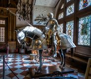 Knight and horse in shining armour. royalty free stock photography