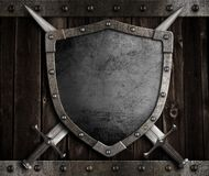 Medieval knight shield and crossed swords on Stock Photography