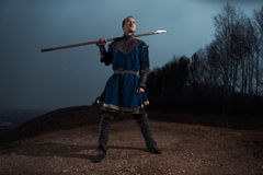 Medieval knight with spear in armor as style Game of Thrones in Royalty Free Stock Photography