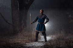 Medieval knight with spear in armor as style Game of Thrones in. Winter Forest Landscapes Royalty Free Stock Photography