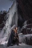 Medieval knight with sword in armor as style Game of Throne Stock Photo