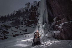 Medieval knight with sword in armor as style Game of Throne Royalty Free Stock Image