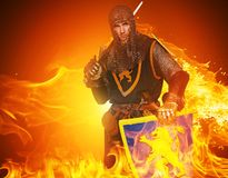 Medieval knight with a word. Medieval knight on fire background Royalty Free Stock Photo