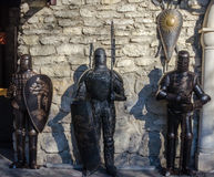 Medieval knights in armor against the wall of the castle Stock Image