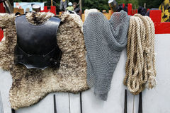 Medieval knights armor display. Medieval knights unifrom with rope and fur hanging ready to be worn Royalty Free Stock Images