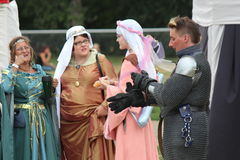 Medieval Knights Displaying his New Wife to the Townspeople Stock Images