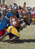 Medieval knights fight. A fight of medieval knights during a historic festival royalty free stock photography