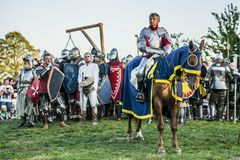 Medieval knights fighting. LIW, POLAND 17 AUGUST: Members of Medieval Reinactment Order fight in Liw Tournament on 17 August 2013 in Liw, Poland stock photo