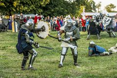 Medieval knights fighting. LIW, POLAND 17 AUGUST: Members of Medieval Reinactment Order fight in Liw Tournament on 17 August 2013 in Liw, Poland stock photos