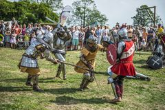 Medieval knights fighting. LIW, POLAND 17 AUGUST: Members of Medieval Reinactment Order fight in Liw Tournament on 17 August 2013 in Liw, Poland stock image