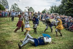 Medieval knights fighting. LIW, POLAND 17 AUGUST: Members of Medieval Reinactment Order fight in Liw Tournament on 17 August 2013 in Liw, Poland royalty free stock photo