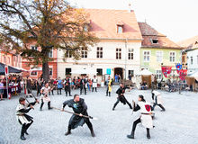 He medieval knights fighting. Sighisoara, Romania. The medieval knights fighting.The Festival Medieval Sighisoara oldest Romanian Medieval Art Festival is Stock Photography