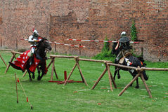 Medieval knights jousting. During a tournament Royalty Free Stock Photos