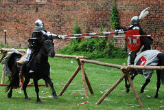 Medieval knights jousting. Medieval knights fighting (jousting) at a tournament Royalty Free Stock Photo