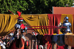 Medieval Knights. Jousting. Medieval Knights on horseback at a jousting competition. Castle Gniew. Poland Stock Photo
