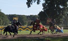 Medieval Knights Jousting at Warwick Castle. Sir Richard De La Bashe and Sir Thomas De Beacham jousting aginat thier enemy at Warwick Castle Royalty Free Stock Photography