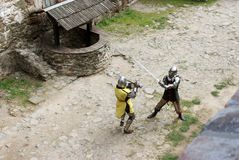 Medieval knights sword fighting. Medieval knights fighting with swords and armor, Bolkow Castle, Poland Royalty Free Stock Photos