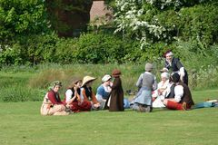 Medieval ladies in re-enactment enjoying picnic Stock Photography