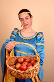 Medieval lady. Offering red apples stock image