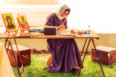Medieval Lady painting outdoor. Stock Photos