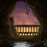 Medieval landscape. A medieval castle viewed from a cave at dusk Royalty Free Stock Photo