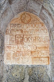 Medieval latin inscription outside italian church Royalty Free Stock Photography