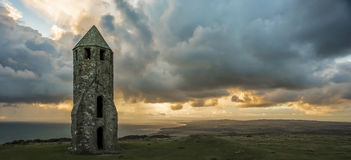 Medieval Lighthouse at with approaching rain at Sundown royalty free stock photo