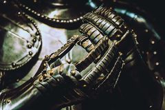 Medieval like armour suit and gloves shining in the dark royalty free stock photography