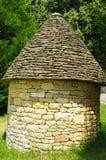 Medieval limestone hut. Shepherd medieval limestone hut in meadow in perigord in france Royalty Free Stock Photos