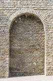 Medieval limestone wall with arch Stock Image