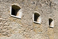 Medieval limestone wall with three windows Stock Photos