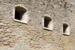Medieval limestone wall with three windows Stock Photos