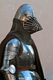Medieval Lombard armor. A man is wearing a reproduction of a medieval Lombard armor with helmet Stock Image