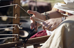 Medieval loom. Image of a woman using a medieval loom Stock Photos