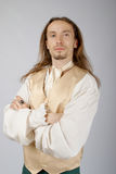 Medieval lord. A young man with long hair in the costume of a medieval lord Stock Images