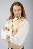 Medieval lord. A young man with long hair in the costume of a medieval lord Stock Photography