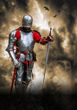 Medieval knight lord poster. Armoured knight with the sword on the battlefield background Royalty Free Stock Images