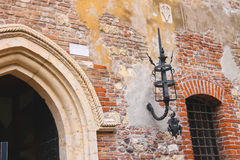 Medieval luminaire on old brick wall of a house Stock Image