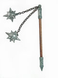 Medieval mace. Miniature of a medieval wooden mace with double spiked balls stock image