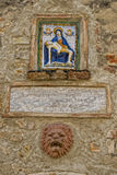 Medieval madonna painting on tuscany village wall Stock Images