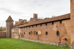 Medieval Malbork castle on the river Nogat Stock Image