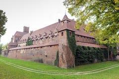 Medieval Malbork castle on the river Nogat Stock Images