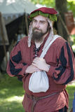 Medieval man. Visby, Gotland island / Sweden -  August 5: Traditional medieval festival with concerts, market and people dressed with medieval costumes - August Stock Photography